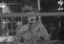 Johnny Hallyday tomando porrada no palco, num show em 1969