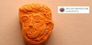 Ecstasy laranja com a cara do Trump
