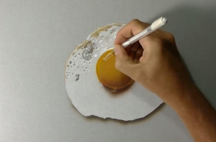 Um cara ensina a desenhar um ovo frito em 3D